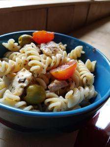 Pasta salad with tuna, cherry tomatoes and olives